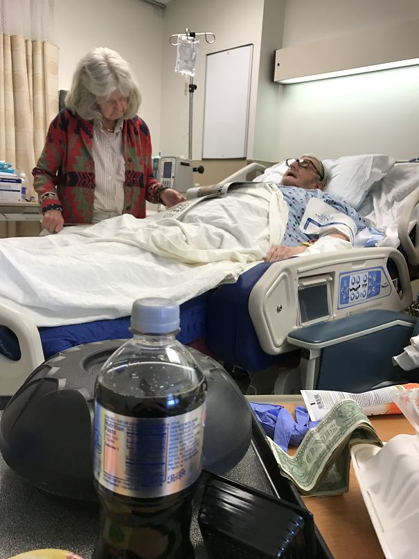 Grandma Reading Grandpa The Paper After His Surgery- She Hasn't Left The Hospital In Weeks