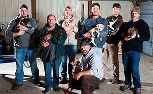 Stray Dog Leads Partying Bachelor Guys To Her 7 Newborns, They Adopt Them All