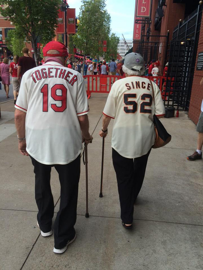 Telling The Whole World About Their Everlasting Love: Elderly Couple Married For 63 Years Wear Adorable Rival Jerseys To Baseball Game