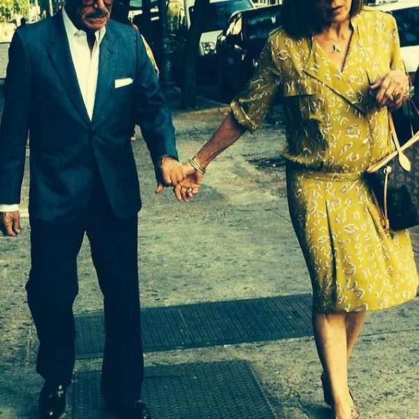 Stylishly Walking Hand In Hand