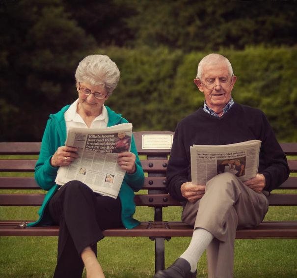 Reading Newspapers In The Park