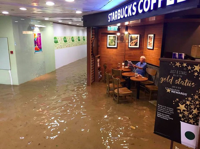 Man Sits In Starbucks Completely Unfazed By Flood, Inspires Hilarious Photoshop Battle (8+ Pics)