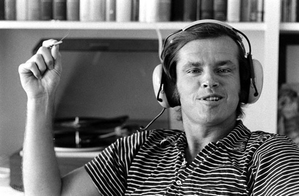 32-Year-Old Jack Nicholson Grins Broadly As He Smokes And Listens To Music On A Pair Of Headphones In His Home, Los Angeles, California, 1969