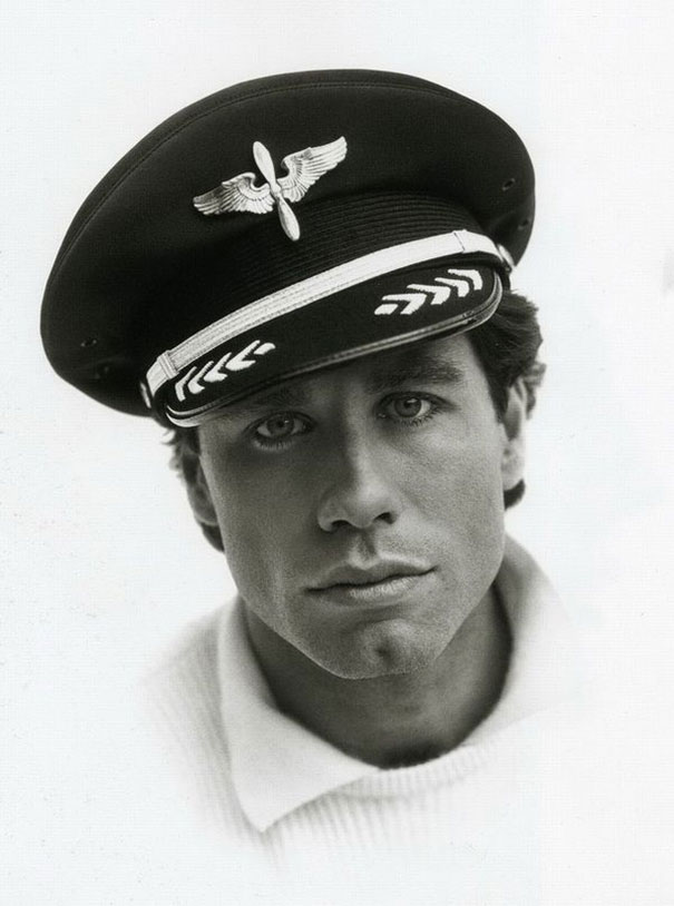 John Travolta Posing With His Pilot Hat, 1985. You Didn't Know He's A Certified Private Pilot, Did You?
