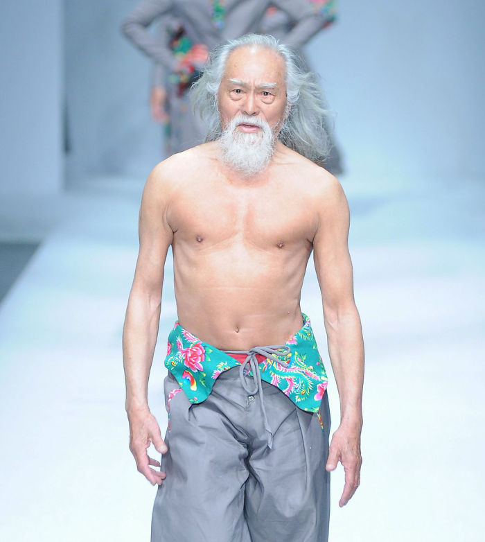 male model disguised as old grandpa on the runway