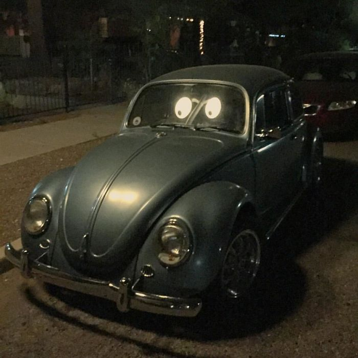 The Reflection From The Street Lamps Makes This Vw Bug Look Like It Has Cartoon Eyes