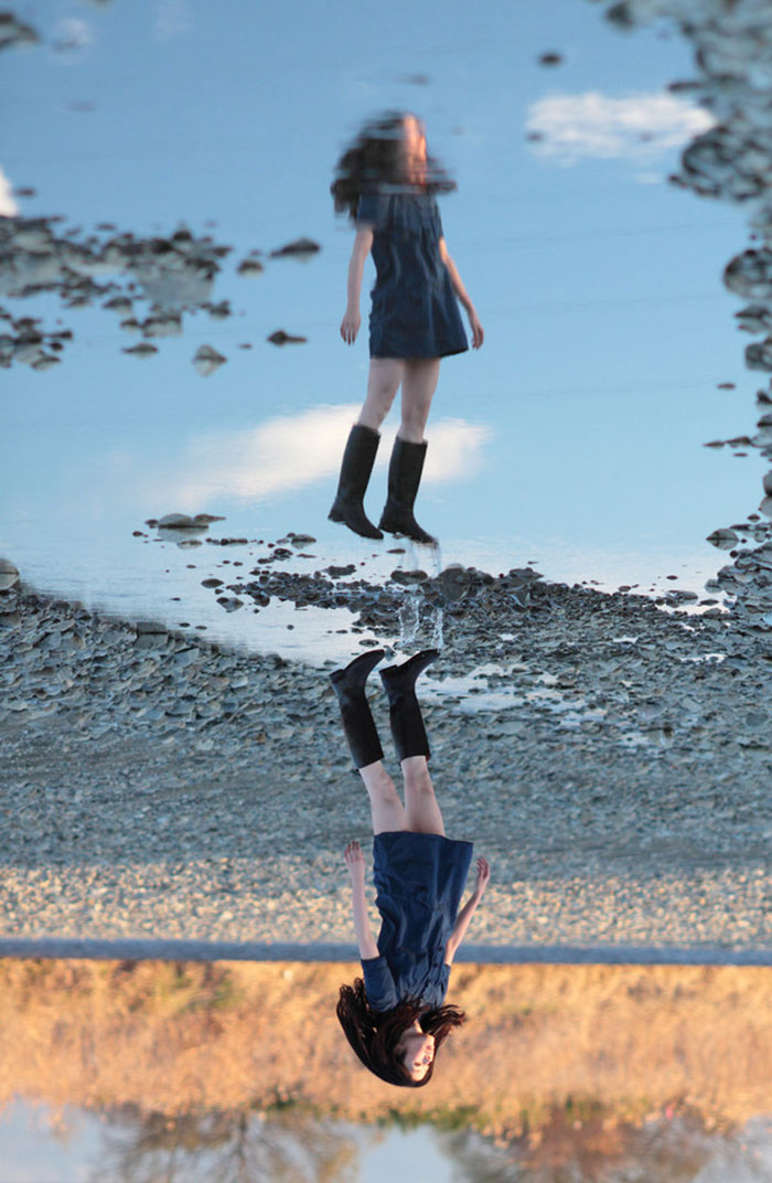 Reflection In A Puddle Makes My Friend Look Like She's Flying