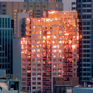 Every Time I Think That This Building Is Burning, But It Is A Reflection Of The Sunset