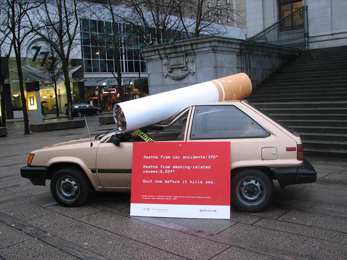 A Car, Crushed By A 7-Foot Cigarette, Grabbed Attention For National Non-Smoking Week And The British Columbia Lung Association