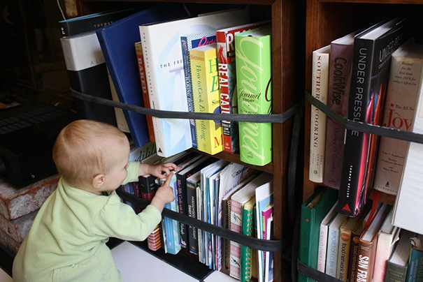 Use Bicycle Inner Tubes Tied Around Each Shelf So Your Baby Can't Access The Books