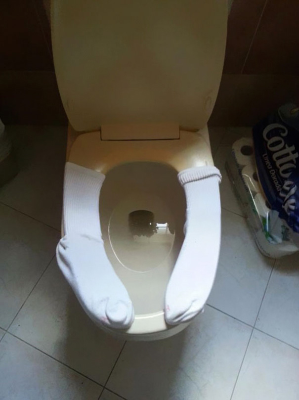 Use Old Socks To Keep The Toilet Seat Warm For Your Kids