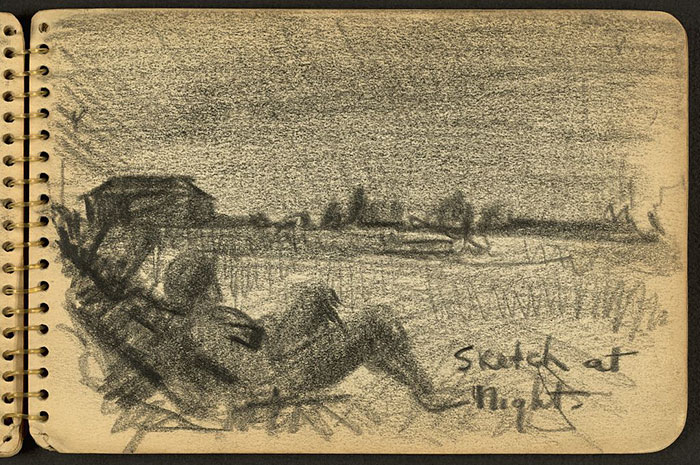 Soldier Sitting On Ground At Night While Stationed At Fort Jackson, South Carolina