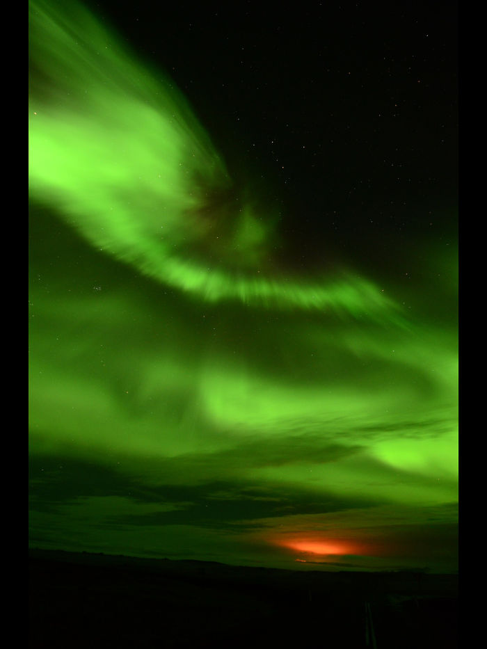 Aurora Borealis And Light From Holuhraun Eruption