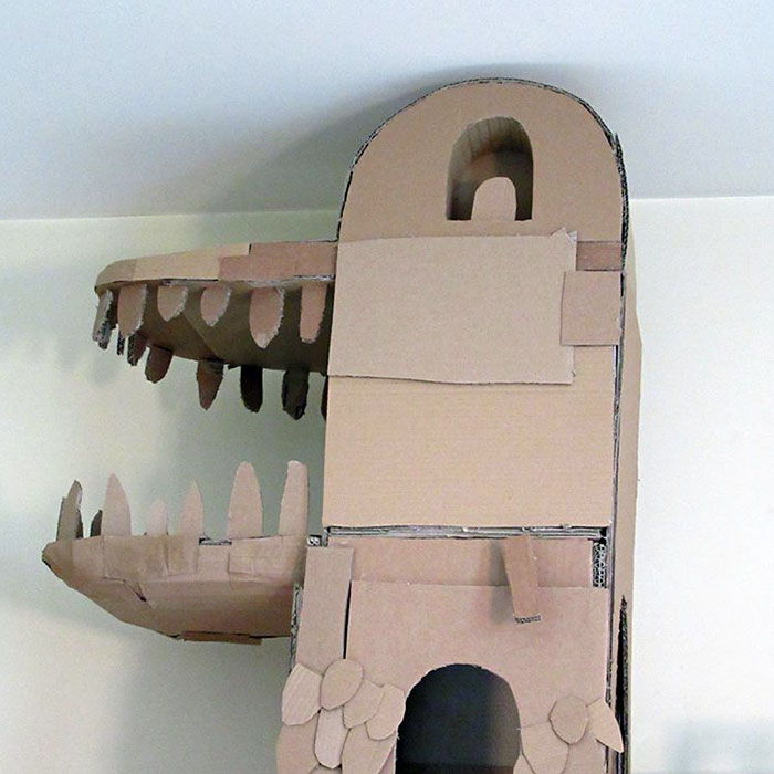 Human Builds A Dragon-Shaped Cardboard House For His Cat In