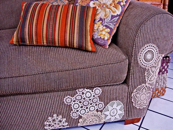 Cover The Cat Scratches On The Sofa With Flea Market Doilies