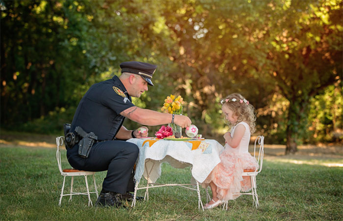 This 2-Year-Old Girl Threw A Tea Party For A Cop Who Saved Her Life