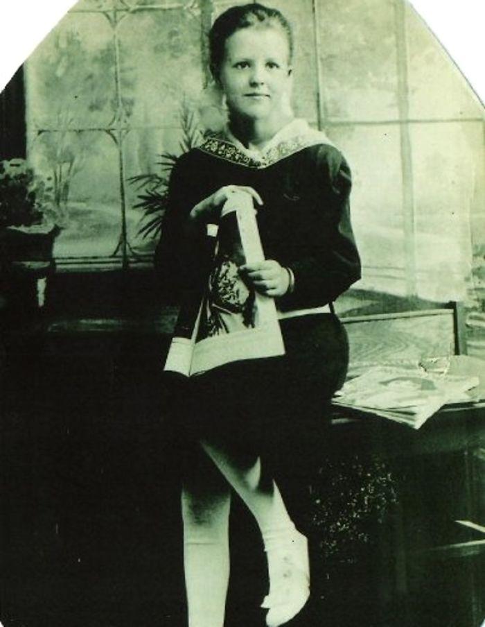 Little Girl Holding Magazine — 1920-something