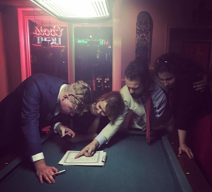 Signing Their Wedding License In A Bar