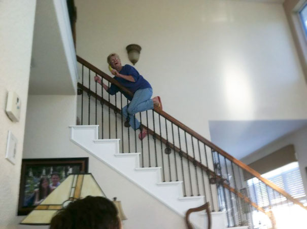 Just My 70 Year Old Grandma Sliding Down The Stair Railing Holding A Banana