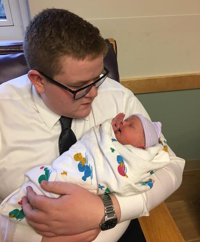brother-wear-suit-niece-newborn-grant-iris-kessler-5
