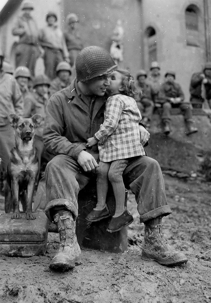 A Little French Girl Gives An American Soldier A Kiss On Valentine's Day, 1945