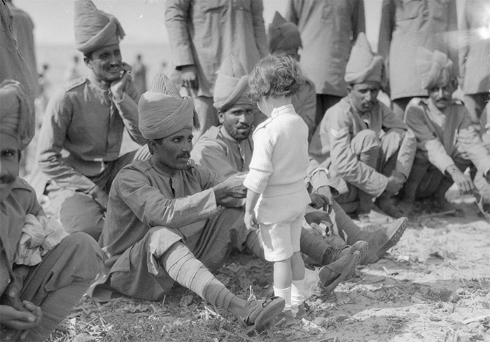 A French Boy Introduces Himself To Indian Soldiers Who Had Just Arrived In France To Fight Alongside French And British Forces, Marseilles, 30th September 1914