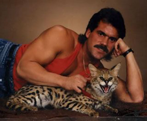 Men Posing With Cats