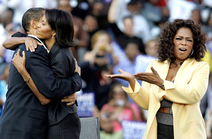 Barack Obama And Michelle Obama Embrace As Oprah Winfrey Campaigns With Them During A Rally At Williams Brice Stadium In Columbia, S.C., Dec. 9, 2008