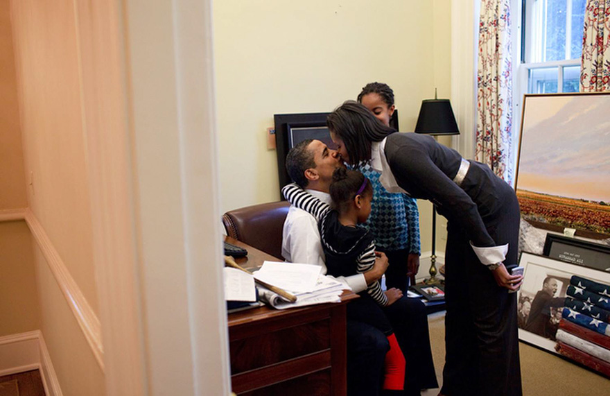 President Barack Obama Visits With His Daughters Malia And Sasha And Kisses His Wife, First Lady Michelle Obama, In A Private Study Off The Oval Office, Feb. 2, 2009