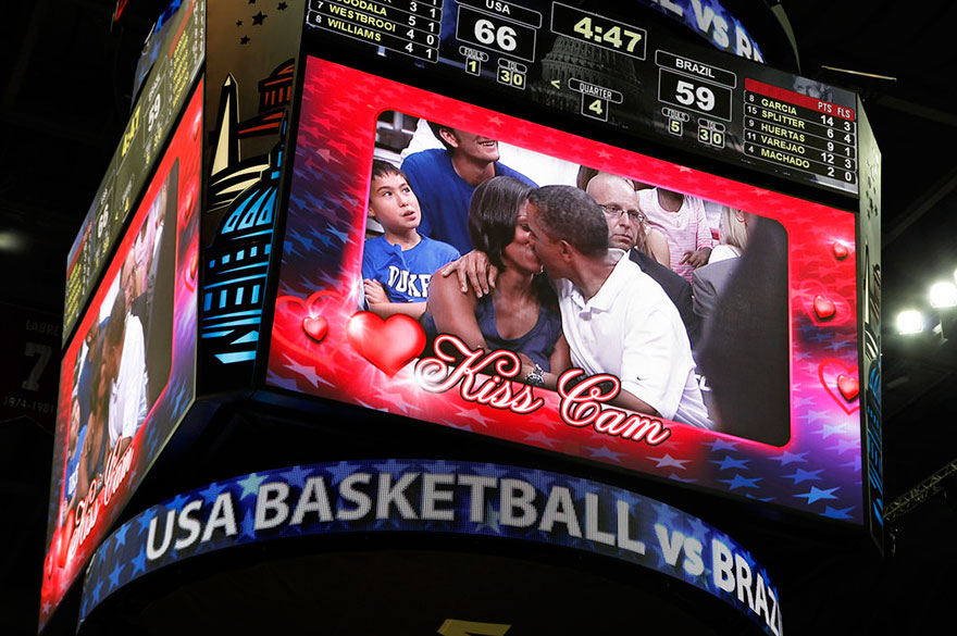 President Barack Obama And First Lady Michelle Obama Are Shown Kissing On The Kiss Cam Screen During A Timeout In The Olympic Basketball Exhibition Game Between The U.S. And Brazil National Men's Teams In Washington On July 16, 2012