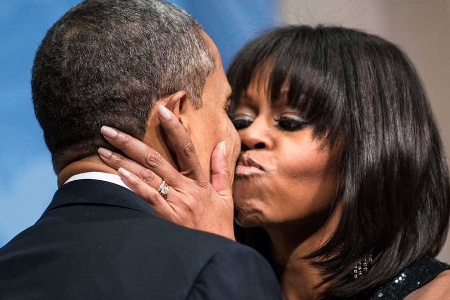 President Barack Obama Is Kissed By First Lady Michelle Obama During An Inauguration Reception At The National Building Museum On Jan. 20, 2013 In Washington, DC
