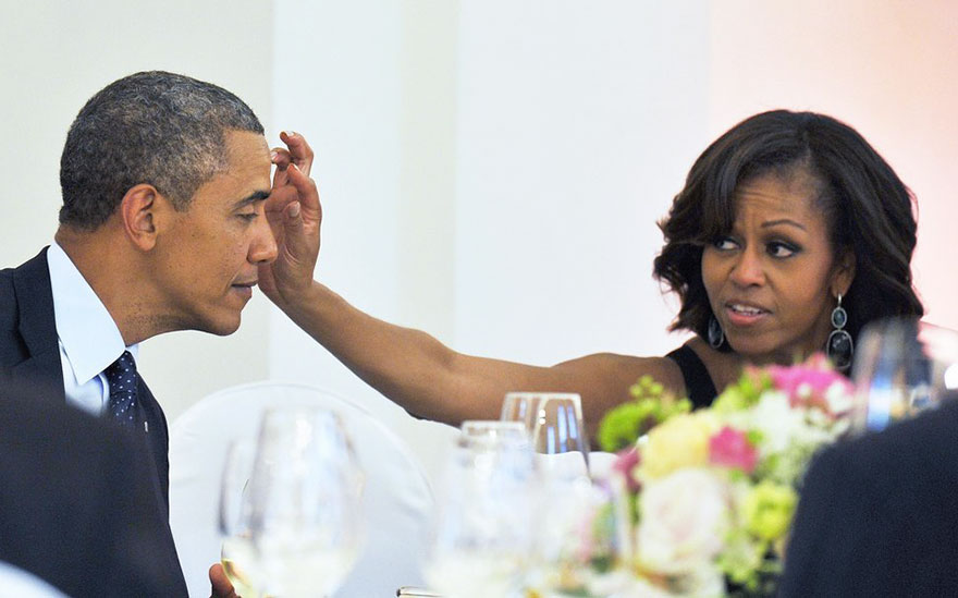 First Lady Michelle Obama Wipes Something From President Obama's Forehead During A Dinner At The Schloss Charlottenburg Palace In Berlin, Germany On June 19, 2013