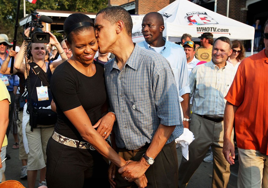 Barack Obama Gives His Wife Michelle A Playful Kiss As They Tour The Iowa State Fair On Aug. 16, 2007 In Des Moines, Iowa