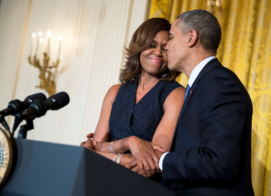 President Barack Obama Kisses First Lady Michelle Obama During Her Remarks At An Affordable Care Act Reception In The East Room Of The White House On May 1, 2014