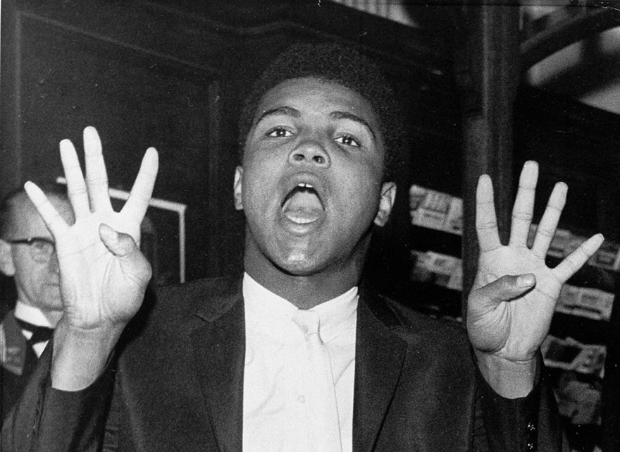 """Muhammad Ali, The """"Louisville Lip,"""" Holds Up Eight Fingers In London June 19, 1963 As He Predicts The Number Of Rounds It Will Take Him To Knock Out Sonny Liston If He Should Get A Chance At The World Heavyweight Championship. Ali Had Predicted An End To His Fight With British Heavyweight Champion Henry Cooper In Five Rounds And That's Just What Happened June 18 In London's Wembley Stadium. Ali Won On A Technical Knockout In The Fifth Round"""