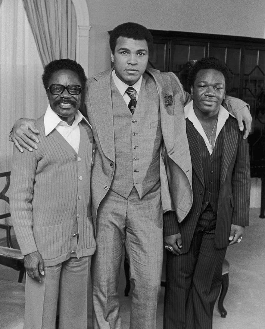 Muhammad Ali Is Photographed With Omar Bongo (Formely Known As Albert Bongo) The President Of Gabon, And His Son Alain At New York's Waldorf-Astoria Hotel On October 21, 1977