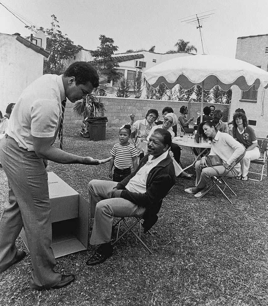 Muhammad Ali Shows Guests, Including Sugar Ray Robinson, A Magic Trick During An Outdoor Party At The Los Angeles Home Of Trainer Drew Bundini Brown In 1981