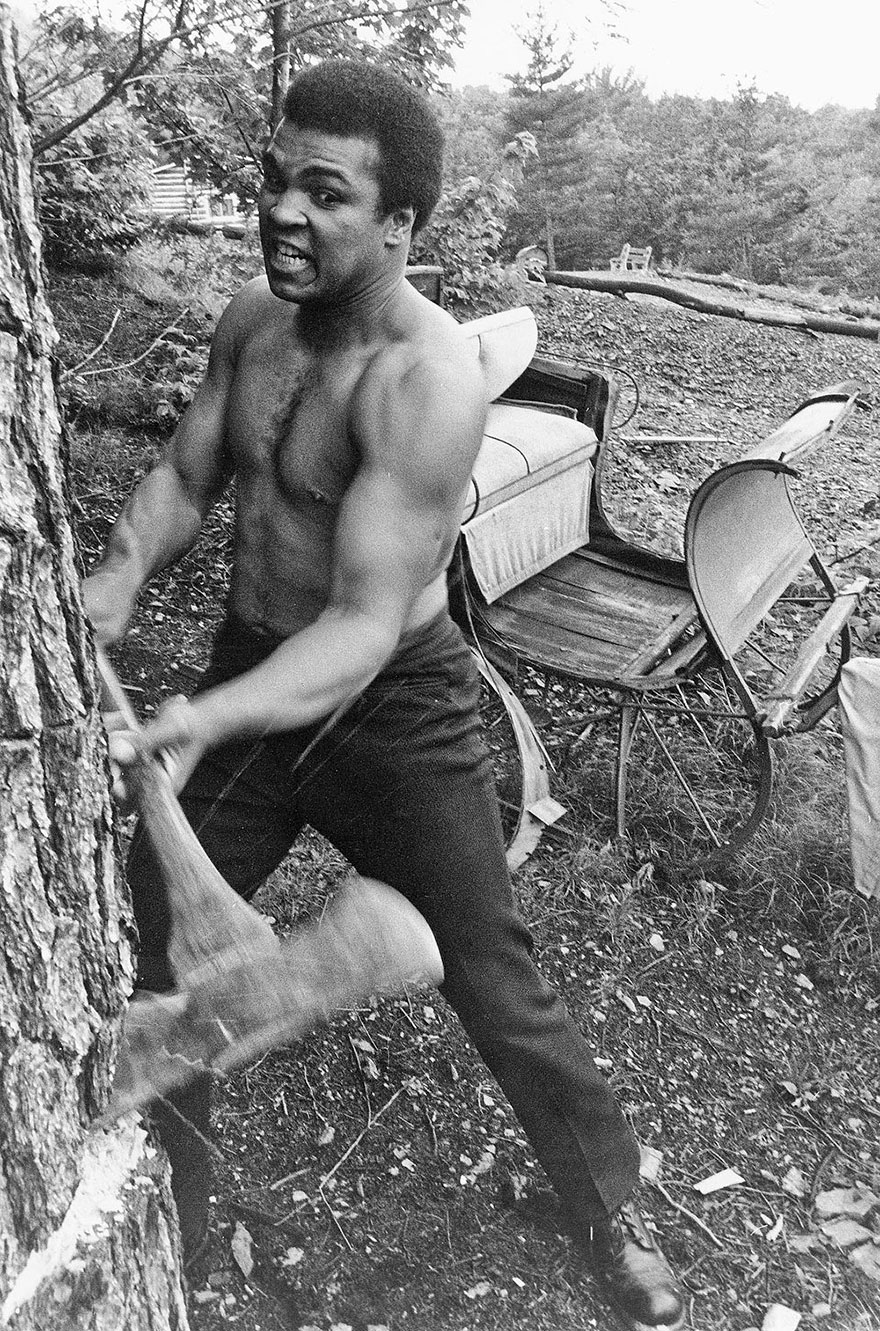 Muhammad Ali Is Pictured Chopping Wood In 1974