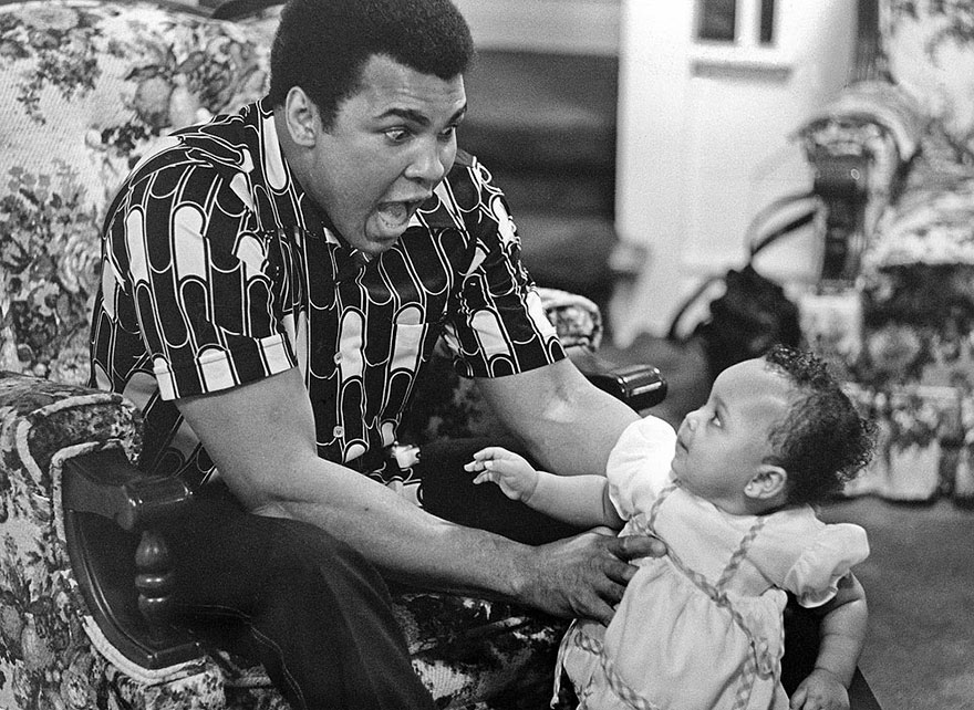 Muhammad Ali Is Photographed Taking Time Away From The Ring To Delight In Cuddling And Playing With Daughter, Baby Hana, 1977