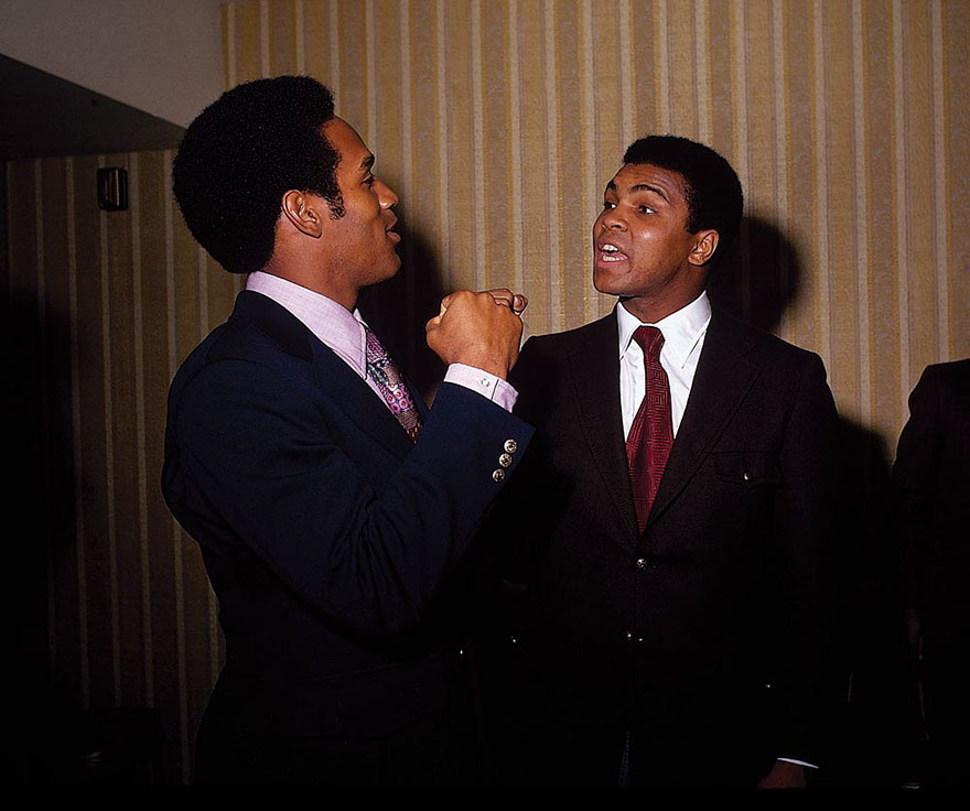 Muhammad Ali Engages In Friendly Banter With Football Star O.J. Simpson In January Of 1971