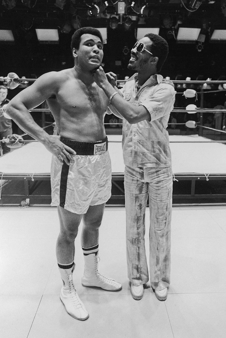 Muhammad Ali Receives A Friendly Jab From Music Sensation Stevie Wonder During Ali's Television Show Taping In 1975