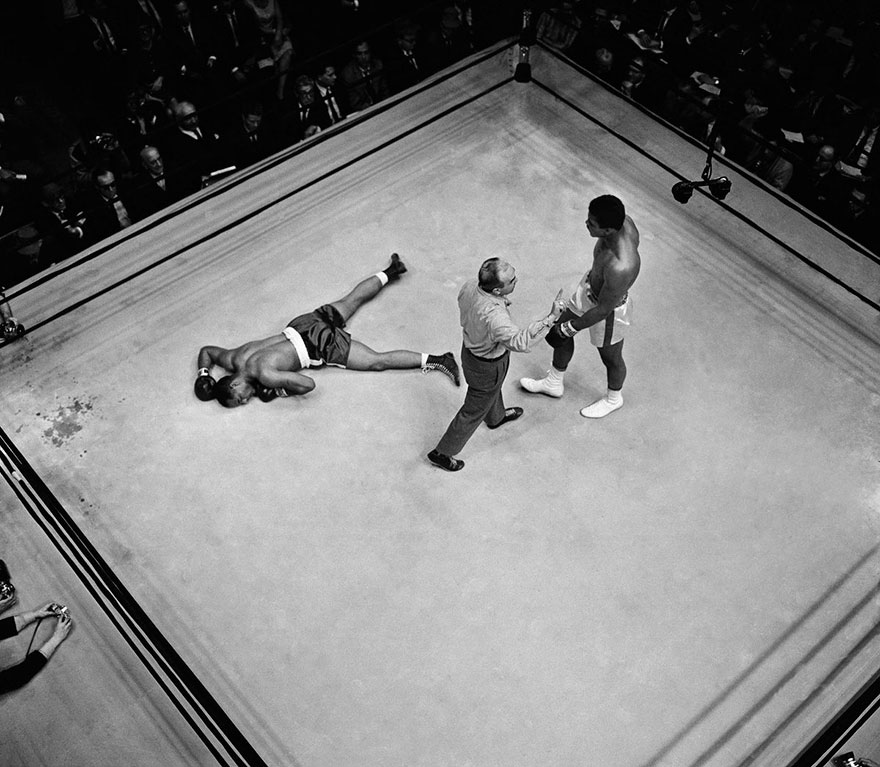 Referee John Lobianco Directs Champion Muhammad Ali To A Neutral Corner Before He Started The Knockout Count Over Prostrate Challenger Zora Folley In The Seventh Round Of Heavyweight Little Fight. Ali Was Declared Victor On A Knockout At 1:48 Of The Round In New York's Madison Square Garden, March 22, 1967