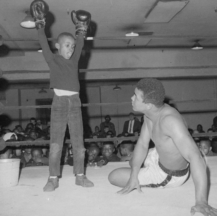 """Keith Green, 9-Year-Old Is Shown Striking A Victorious Pose After """"Flooring"""" Muhammad Ali At Madison Square Garden In New York, March 14, 1967"""