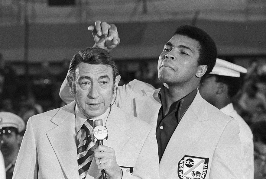 Muhammad Ali, Former World Heavyweight Boxing Champion, Toys With The Finely Combed Hair Of Television Sports Commentator Howard Cosell Before The Start Of The Olympic Boxing Trials, Aug. 7, 1972, In West Point, NY