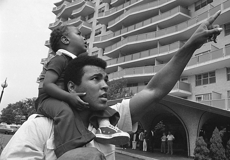 Muhammad Ali Carries His Son, Muhammad Ali, Jr., On His Shoulders, Aug. 24, 1974, As He Points Toward The Building In Cherry Hill, N.J.