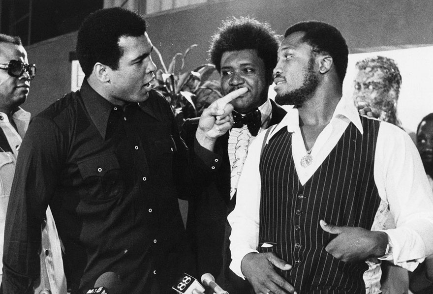 Sports Promoter Don King Stands Between Muhammad Ali, Left, And Joe Frazier In New York, Thursday, July 17, 1975, After It Was Announced That Ali And Frazier Will Meet In A Title Bout Dot