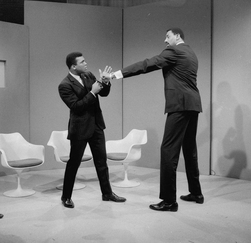 Basketball Star Wilt Chamberlain Extends A Long Left In The Direction Of World Heavyweight Champion Muhammad Ali As They Met At An Abc Television Studio In New York, March 10, 1967. Chamberlain Stands 7 Feet, 1 Inch Tall, And Ali Is 6 Feet, 2 Inches Tall. Chamberlain's Reach Is Over 90 Inches, Ali's Is 79 Inches.
