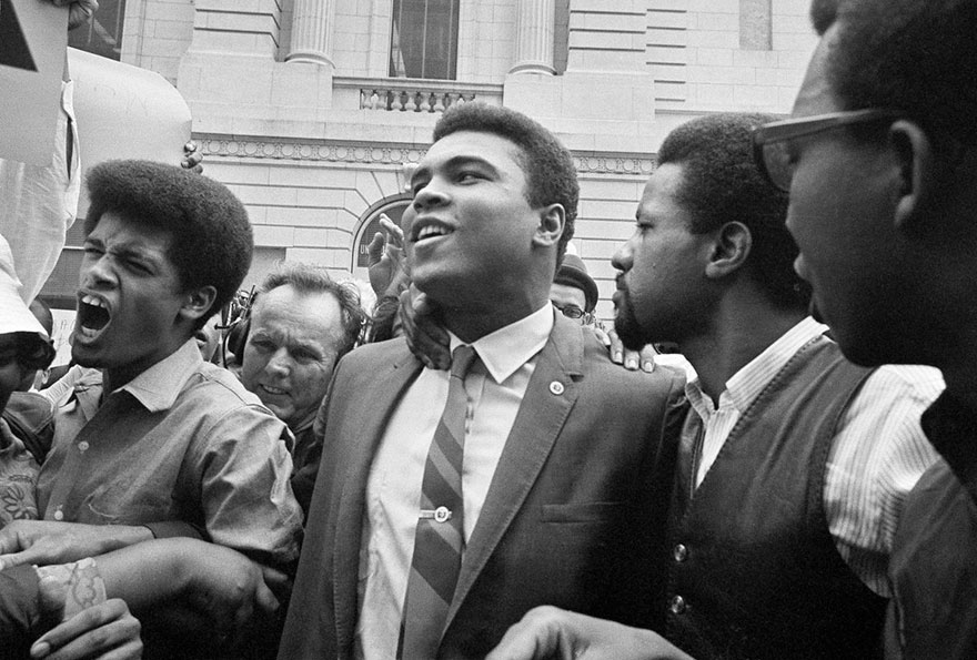 Muhammad Ali, Center, Leaves The Armed Forces Induction Center With His Entourage After Refusing To Be Drafted Into The Armed Forces In Houston, April 28, 1967. Hundreds Of Ali Fans And Supporters Filled The Streets To Greet Him When He Left The Building