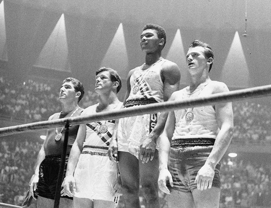 As A Bubbly Teenager At The 1960 Olympics In Rome, Clay Parroted America's Cold War Line. He Took The Gold Medal For Light Heavyweight Boxing, Beating Out Zbigniew Pietrzykowski Of Poland, Right, And The Joint Bronze Medalists Giulio Saraudi Of Italy And Anthony Madigan Of Australia