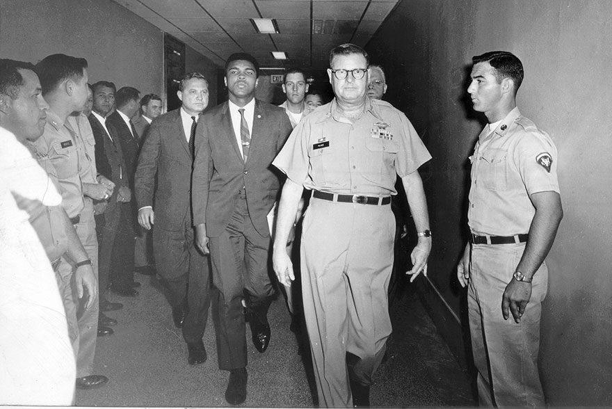 Lt. Col. J. Edwin Mckee Escorting Clay From The Armed Forces Examining Station In Houston On April 28, 1967, After He Refused To Be Drafted Into The Army, Requesting Conscientious Objector Status. Clay Was Stripped Of His Title By Boxing Commissions And Was Convicted Of Draft Evasion. He Did Not Fight For Three And A Half Years
